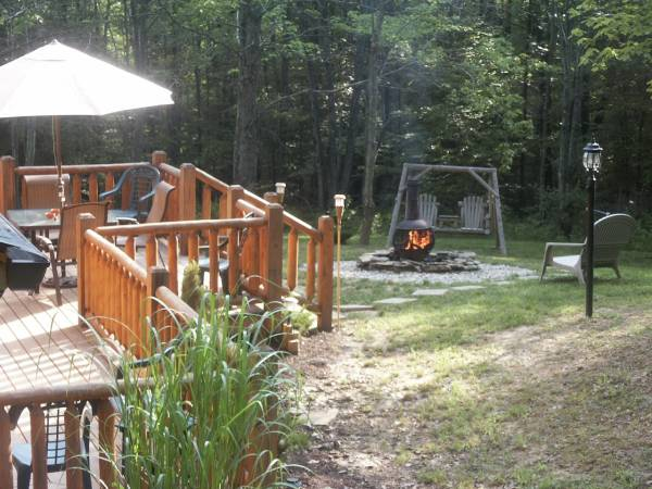 Private wooded seclusion surrounds the many decks.